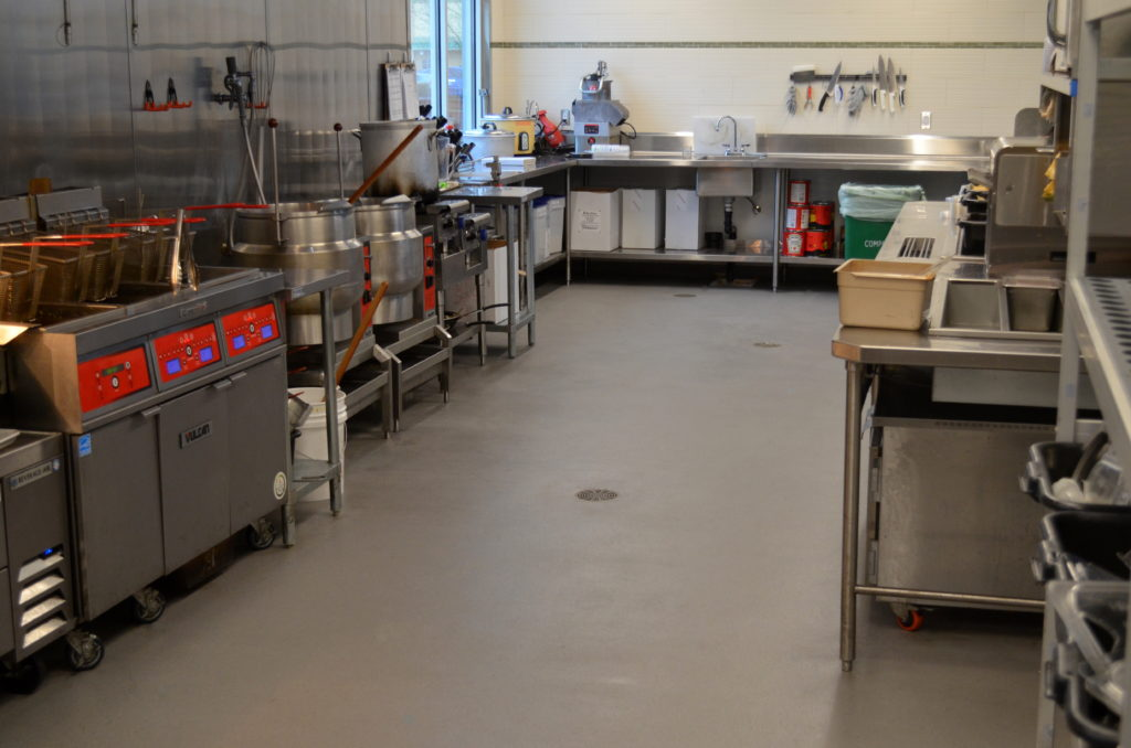 Commercial Kitchen with Epoxy Quartz and Integral Cove