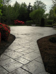Stamped Resurfacing of an Aggregate Patio with and Addition.