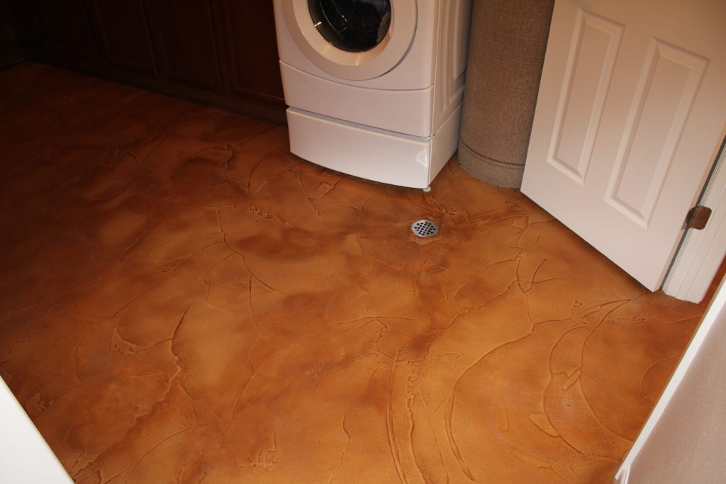 Stained Micro-topping in a Basement Laundry After a Flood.
