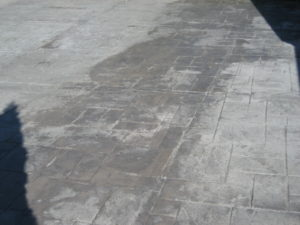 A Stamped Driveway Where Most of the Color Has Worn Away