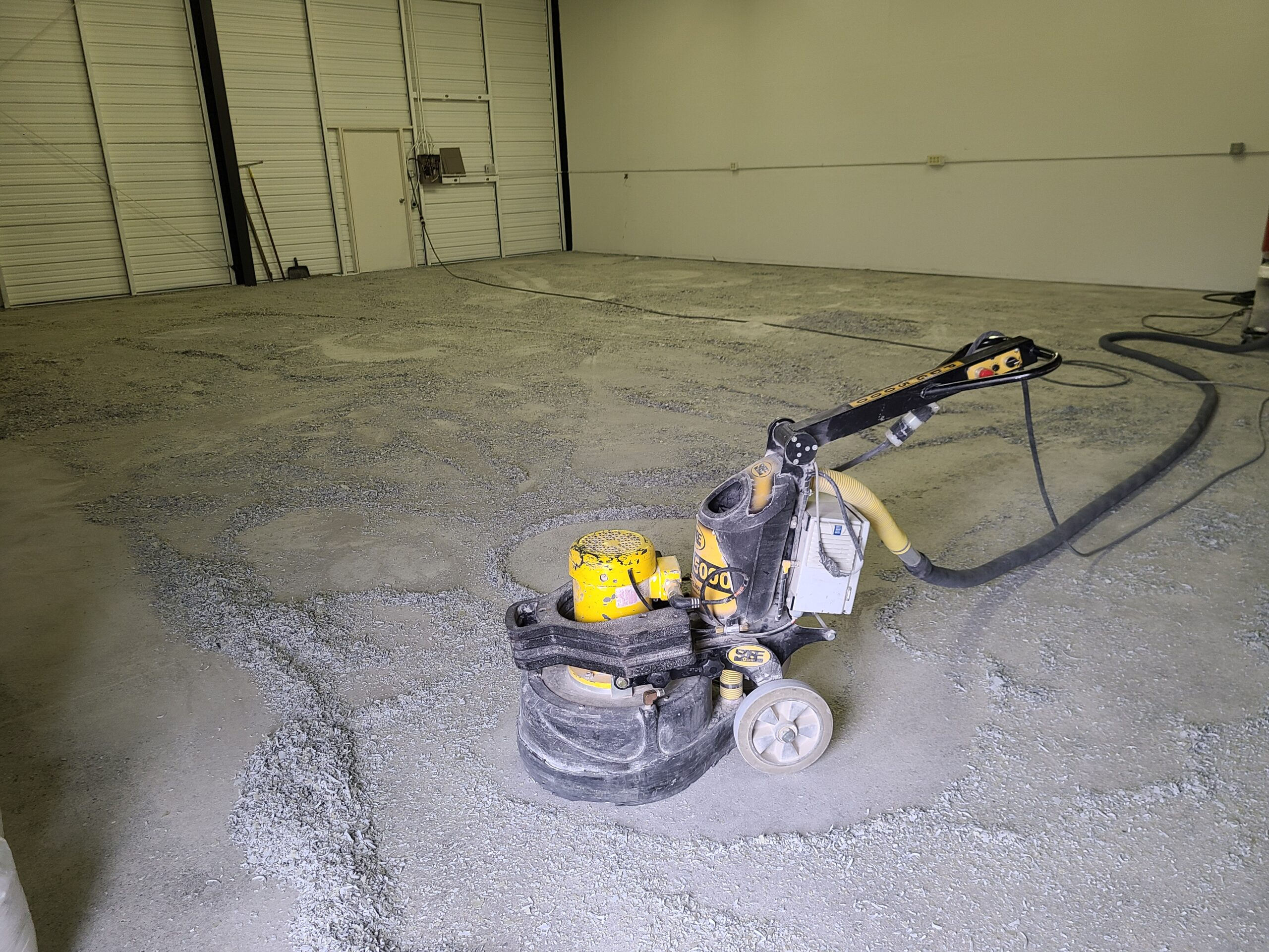 Grinding of a Failed Epoxy Coating in an Airplane Hangar